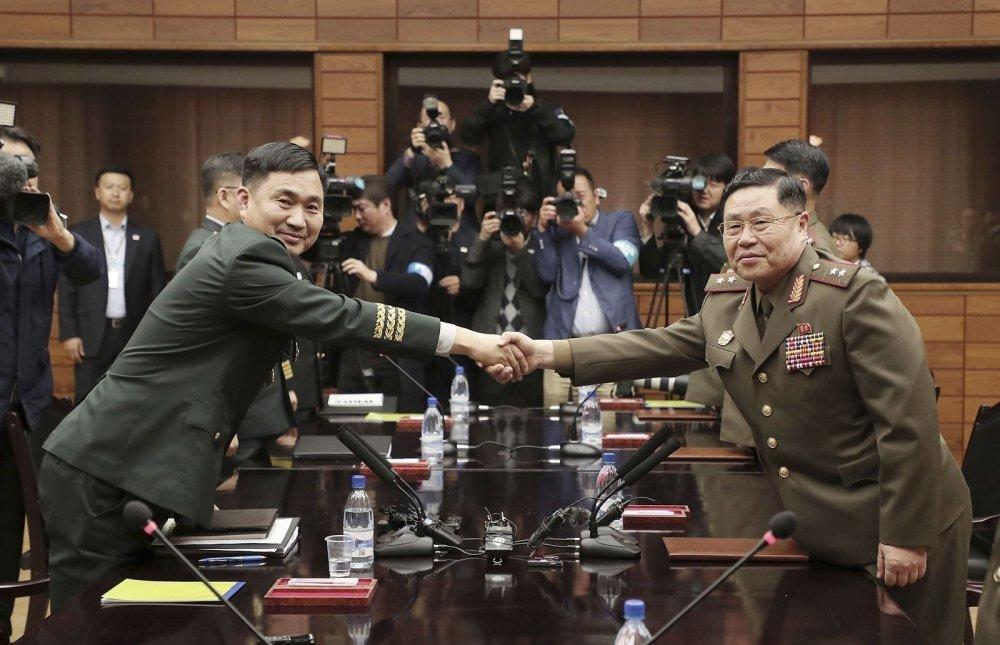 Хоёр Солонгос хилийн харуулын нийт 22 постыг татан буулгахаар боллоо